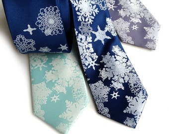 Snowflake necktie. Winter scene mens tie. Snow flake screenprinted holiday necktie. White snow and star print.