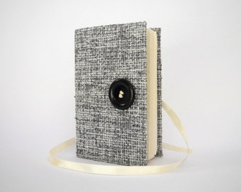 Handmade journal notebook made of raw grey black and white rustic fabric, Opens with a matching black button and white ribbon, Lined journal