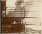 vintage photo 1899 Baby Darling Leans back on Wooden Box Her Playpen
