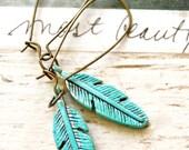 Bohemian feather earrings. tiedupmemories