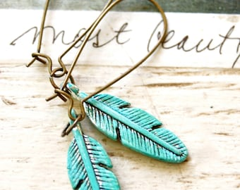 Bohemian feather earrings. tiedupmemories