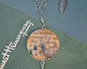 One of a kind collage on long sterling necklace with deer and forest set under resin. Miniature woodland scene