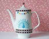 Large peacock, spirograph, triangles and bunting teapot