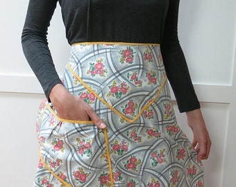 Mid-Century Woman's Half Waist Apron with Flowers and Arcs in Gray, Pink, Yellow and Green