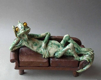 Lizard Reclining on Couch Whimsical Ceramic Sculpture: Lounge Lizard