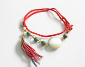 Red bohemian double wrap fishtail woven friendship bracelets pearls raw turquoise gold wire tassel ends summer spring free people inspired