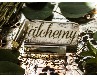 alchemy natural perfume oil 2-vial mini sampler - primary notes: firewood, moss and lotus
