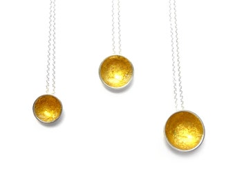 small 10mm supernova silver pendant with 24ct gold leaf,