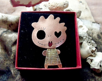 CUCA, cute copper and brass girly monster brooch. Plaid dress, curly hair, a heart in her eye and red lips