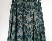 Vintage dark blue pleated lightweight cotton summer skirt with black beige flower pattern. Size medium M EU 38 40