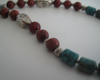 Turquoise, coral, and Thai Hill Tribes silver necklace.