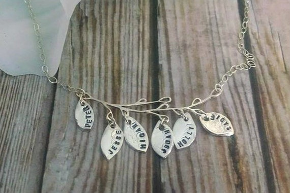 https://www.etsy.com/listing/207268579/hand-stamped-family-tree-necklace-3?ref=shop_home_active_9