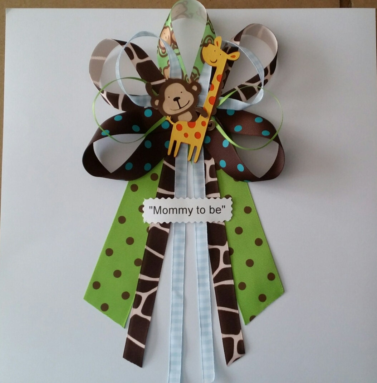 blue jungle theme monkey and giraffe baby shower pin corsage
