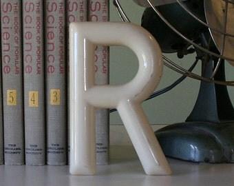 Letter 'R' in Cream Color