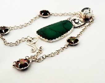 Silver Necklace with Carved Turtle Crystal over Peridot and Ruby, Pierced Scythian Deer and Turquoise Stone.