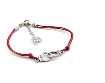 Fifty shades of Grey cuffs bracelet on red leather