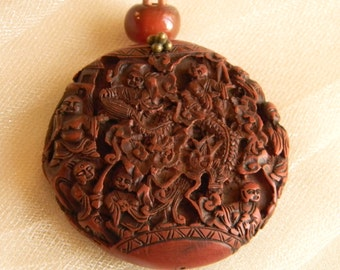 Molded resin pendant w leather cord necklace , beaded jewelry , Buddhist monk temple , antler bead charm , vintage Buddhist pendant , resin
