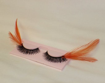 Orange and black feather lashes with orange jewels