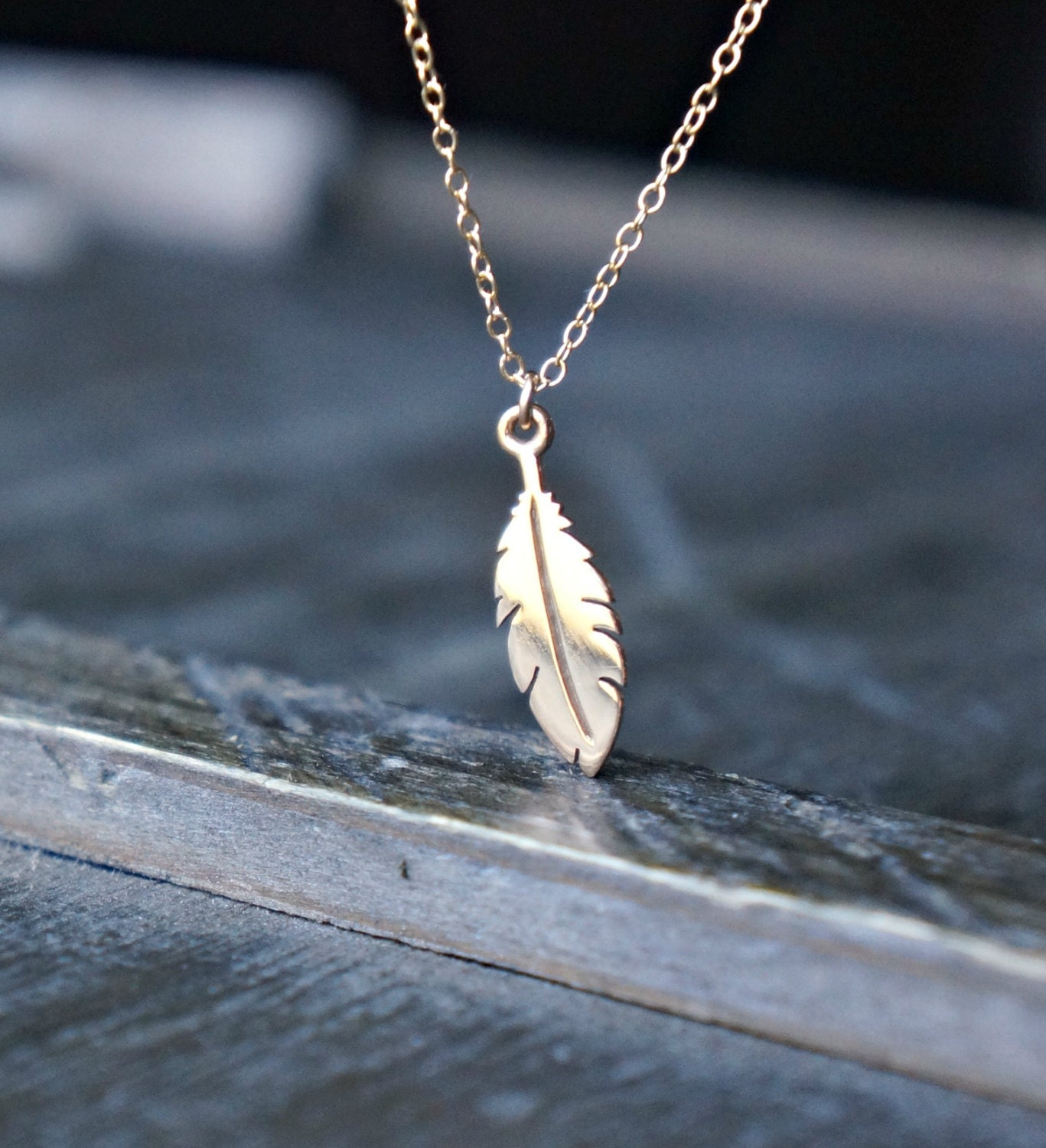 tiny feather necklace small gold feather pendant on a gold