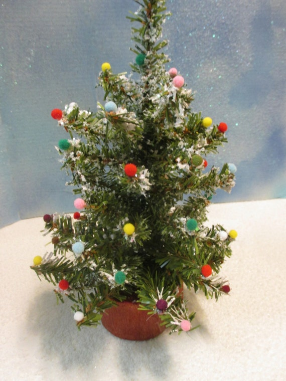 Cedar stump artificial christmas tree with dusting of snow and