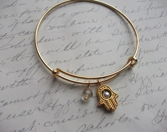 Hamsa hand gold bangle bracelet with crystal