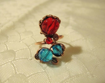 Red and Light Blue Ring. Handmade Ring set with Red and Light Blue Glass Beads. Copper Wire Wrapped Ring. Spiral wiring.