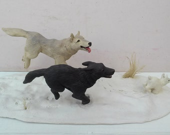 Wolves and Snowshoe Hare Sculpture