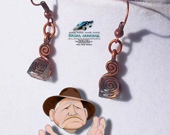 "Authentic movie artifact earrings made from ""It's a Mad, Mad, Mad, Mad World"" car glass."