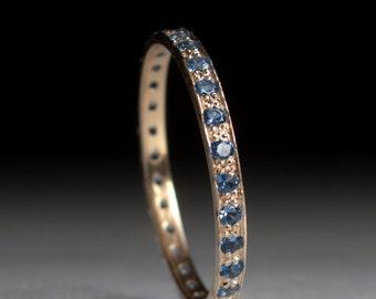 Gold Blue topaz Eternity ring