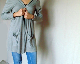 Women cardigan with long sleeves / women jumper available in grey and black.