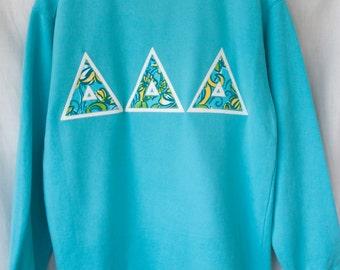Lagoon Sweatshirt With Tri Delta Lilly Print on White