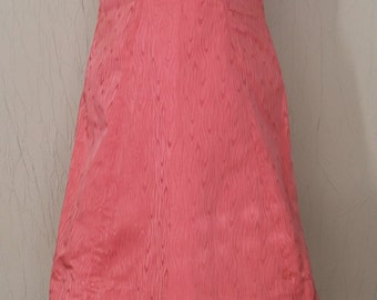 Pink dress with beads of the 1950s