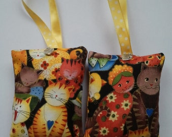 pair of handmade, Home Grown Lavender filled hanging cat print bags for cat lovers