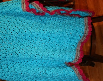Warm Crocheted Blanket with Shell-Stitched Border