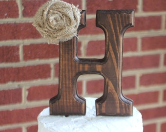 Rustic wood letter initial wedding cake topper. With optional burlap flower.