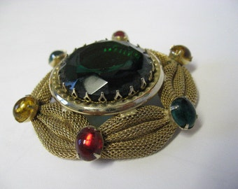 Vintage Bohemian brooch with mesh and glass cabochons.