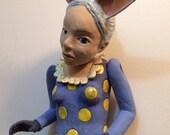 Rabbit girl marionette wall sculpture ceramic.