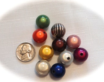 10 sets of colorful beads for interchangeable earrings.  Set 2:  green, orange, yellow, brown, lt pink, ivory, blue, white, purple, pewter