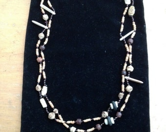Handmade mixed beaded necklace with wood and shells.