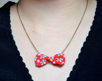 Necklace with a little delicate bow in Petit Pan fabric(red with little flowers)