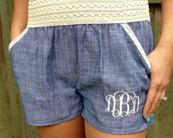 Monogrammed crochet trimmed denim shorts