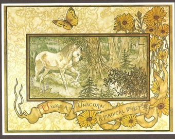 Unicorn in forest with flower border book plate