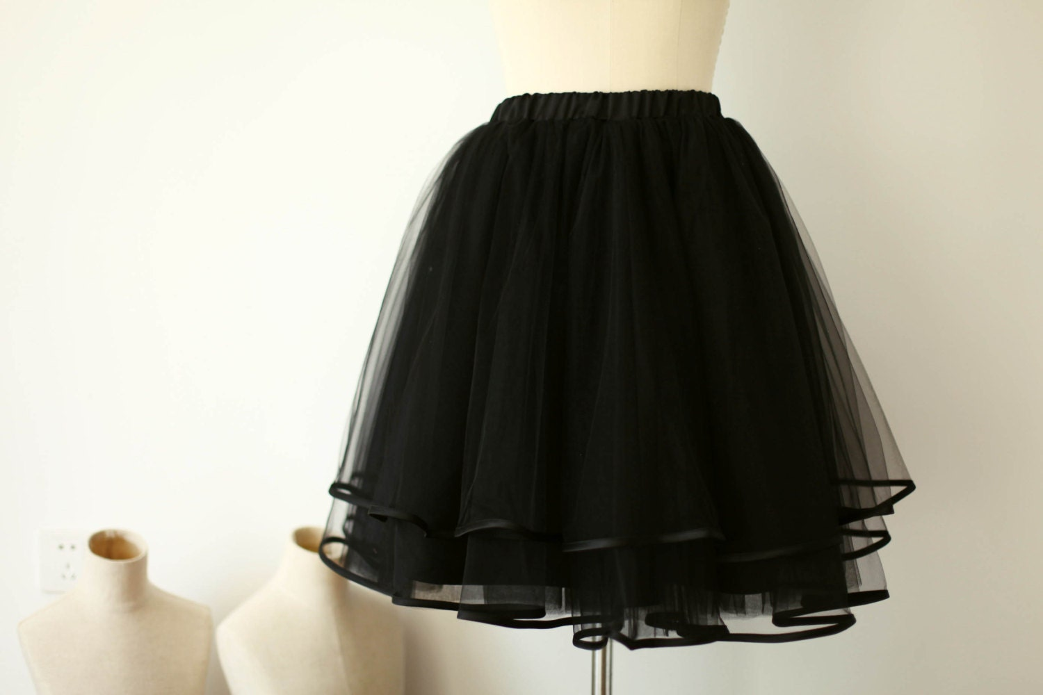 The second layer is a layer of tulle. The under layer is a smooth polyester lining which prevents the tulle from scratching against your sensitive skin.