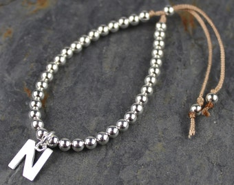 Personalised Silver Bead and Cotton Thread Friendship Bracelet with Solid Silver Cut Out Letter Charm