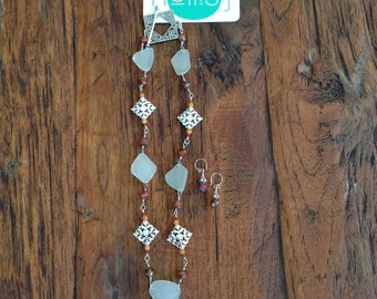 Sea glass and sterling silver necklace with coordinating earrings
