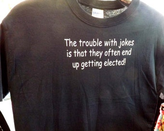 Humorous t-shirt ,  the trouble with jokes is that they often end up getting elected ... funny saying tee shirt