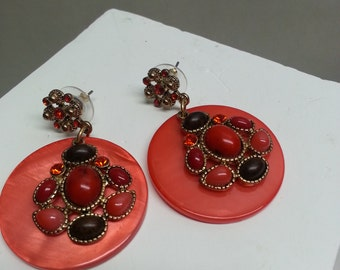 Playful earrings in bright orange puffed acrylic round with cushion mound acrylic beads.  **FREE SHIPPING**