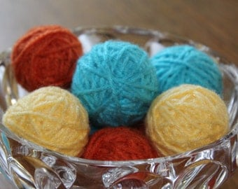 yarn ball vase filler, yarn ball bowl filler, yarn deco balls, orange, yellow, and teal yarn balls