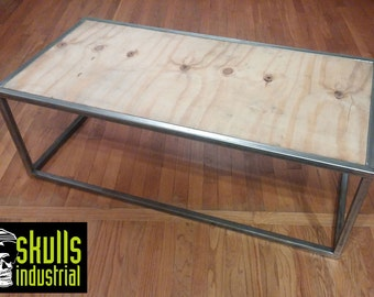 Coffee Table. Welded steel with reclaimed plywood top.