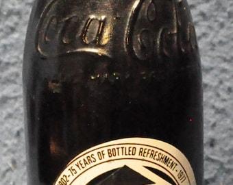 75th anniversary Coca Cola bottle, unopened, Atlanta Ga.
